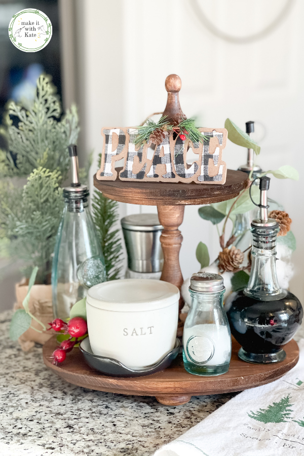 This DIY tiered tray layers and stacks unfinished wood pieces to make a beautiful multi-level tray for seasonal or functional decor! #diydecor #woodworkingforbeginners #diyhomeprojects #tieredtray