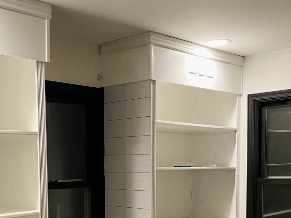 This DIY Built in Shelving is a great project for beginners who want a budget friendly way to add custom built in storage for their space. #built ins #diy built ins #built in shelving #diy wood projects #diy home projects