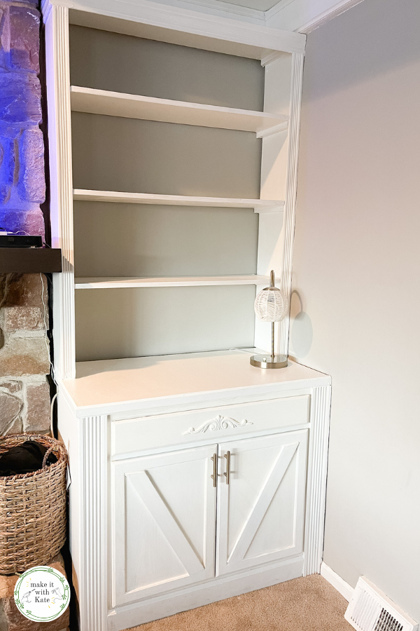 These DIY built ins with stock cabinets are a simple way to create built in shelving in your living room. Built a bookcase on top of a stock cabinet, then trim and paint!  #livingroomdecor #builtins #homewoodworking #diyhomedecor #diyhomeprojects