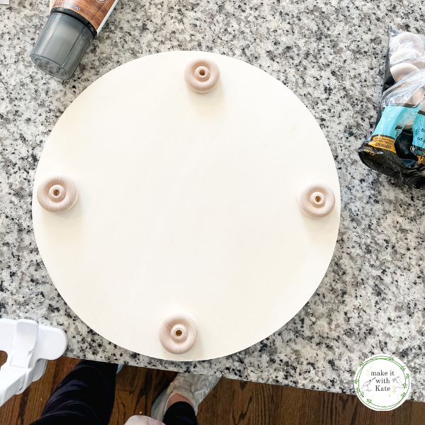 This DIY farmhouse tray uses an unfinished wooden round, stain and hardware to create a beautiful single tray for all of your home decor. #diyhomedecor #diyfarmhouse #woodtraydecor