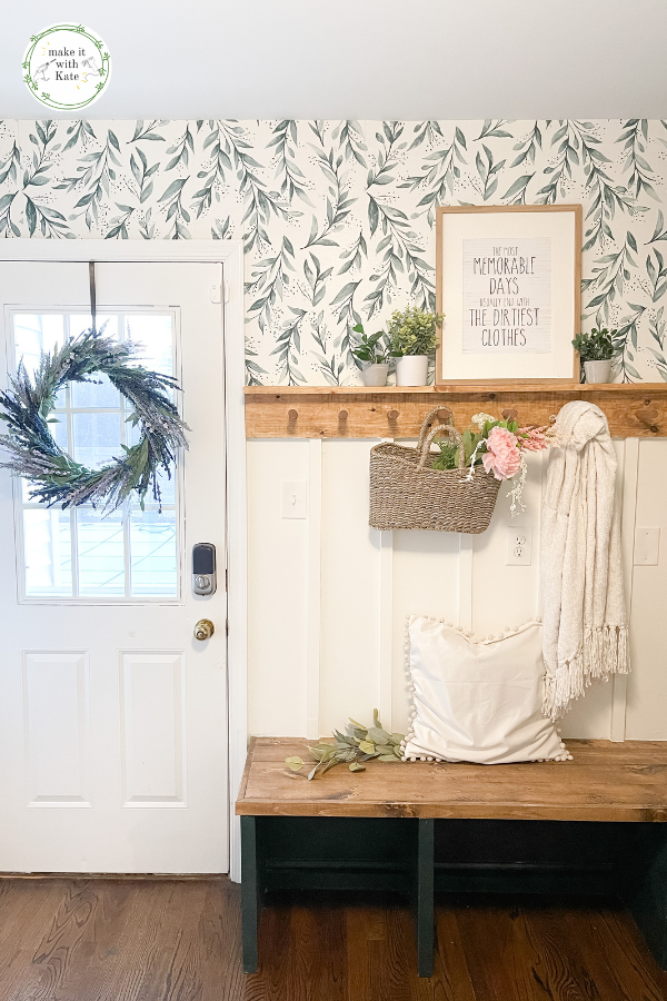 This DIY mudroom has a beautiful corner bench, lockers, cabinets, and a peg rail batten wall. See all of the tutorials and FAQs. #diymudroom #mudroombuild #mudroomstyling #homedecor