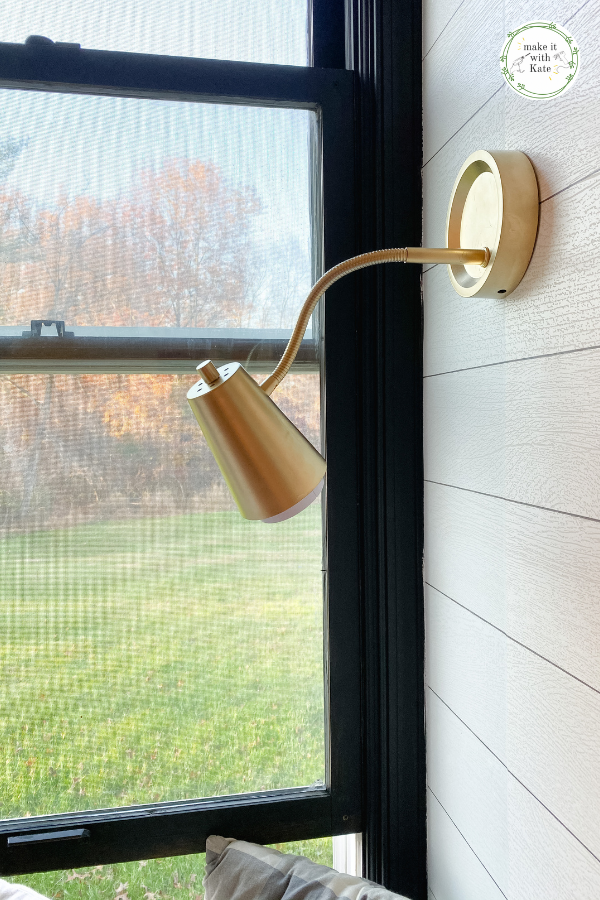 This DIY wall sconce is made from an inexpensive plastic table lamp. You won't believe how beautiful this looks on the wall! #diydecor #homedecor #budgetdecor #diy #playroom #wallsconce #lighting