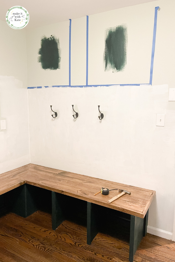 These mudroom locker cabinets use stock wall cabinets as a top for the built in lockers. They make a great finish for a DIY mudroom. #diymudroom #mudroomcabinets #stockcabinets #builtincabinets #stockcabinetbuilds